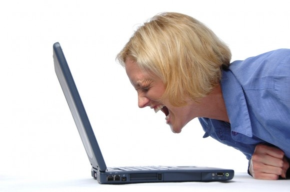 Buisinesswoman screaming at her lap top