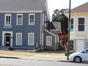 Locals worked to clean up this house on Jefferson St. in Napa, which had its foundation and side staircases damaged by the M6.0 Napa earthquake.