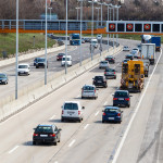 cars on a highway with a speed limit icon photos of transport, m