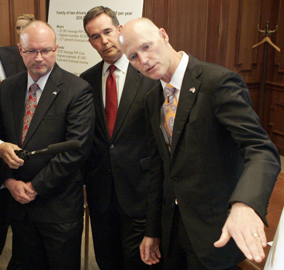 From left, insurance commissioner Kevin McCarty, CFO Jeff Atwater and Gov. Rick Scott. (AP Photo/Steve Cannon)