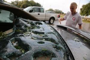 Inspecting hail damage. AP Photo/The Dallas Morning News, Nathan Hunsinger