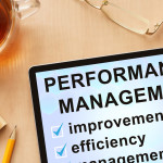 Tablet with words performance management.