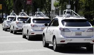 A row of Google self-driving Lexus cars at a Google event outside the Computer History Museum in Mountain View, Calif. Of the nearly 50 self-driving cars rolling around California roads and highways, four have gotten into accidents since September, 2014.  (AP Photo/Eric Risberg, File)