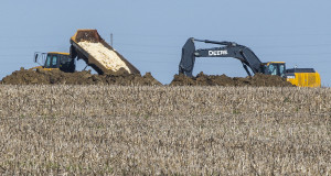 Dead chickens are buried in a farm field in Iowa in May 2015. (Rodney White/The Des Moines Register via AP)
