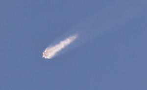 The SpaceX Falcon 9 rocket and Dragon spacecraft breaks apart shortly after liftoff at the Cape Canaveral Air Force Station in Cape Canaveral, Fla., on Sunday. The rocket was carrying supplies to the International Space Station. (AP Photo/John Raoux)