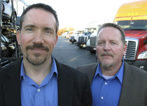 "Scott Cornell, left, and Douglas ""DZ"" Patterson, theft investigators for The Travelers Cos., pose at a truck stop in Willington, Conn. Cornell and Patterson work to prevent cargo theft, including deploying a ""sting trailer"" packed with hidden surveillance equipment. Cargo theft has become a huge problem that the FBI says causes $15 billion to $30 billion in losses each year in the U.S. There were 152 cargo thefts nationwide in July, August and September. (AP Photo/Dave Collins)"