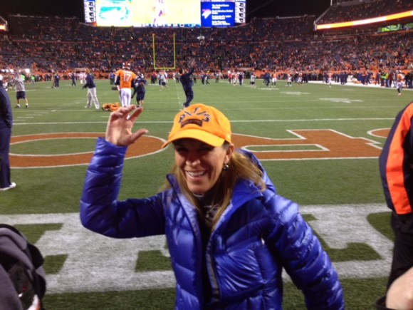 Carol Walker, executive director of the Rocky Mountain Insurance Information Association, at Mile high stadium for the Denver Broncos vs. Kansas City Chiefs game in 2014.