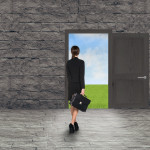 Composite image of Businesswoman walking away in room with door