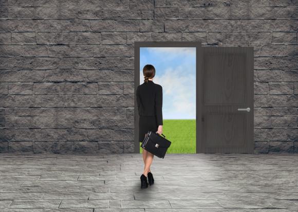 Composite image of Businesswoman walking away in room with door