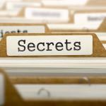 Secrets Concept. Word on Folder Register of Card Index. Selective Focus.