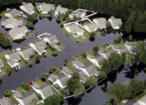 This aerial photo show flooding around homes in the Carolina Forest community in Horry County, between Conway and Myrtle Beach, S.C. The state was  pummeled in early October by a historic rainstorm that caused widespread flooding and multiple deaths. (Janet Blackmon Morgan/The Sun News via AP)