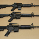 In this Aug. 15, 2012 file photo, three variations of the AR-15 assault rifle are displayed. While the guns similar, the bottom version is illegal in California because of its quick reload capabilities. Omar Mateen used an AR-15 that he purchased legally when he killed 49 people in an Orlando nightclub. . (AP Photo/Rich Pedroncelli,file)