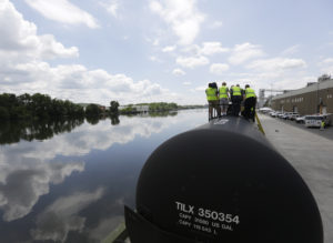 Firefighters and other first responders are familiarized with tank cars on the CSX Safety Train next to the Hudson River in the Port of Albany on Thursday, June 5, 2014, in Albany, N.Y. The train is equipped with four oil tankers and two classroom cars and is making a whistle stop in Albany as part of a multi-state tour providing enhanced safety training in response to increased shipments of North Dakota crude oil. Albany has become a major hub for shipping the crude oil, which arrives daily in hundreds of tank cars to be shipped down the Hudson to New Jersey refineries. (AP Photo/Mike Groll)