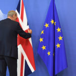A member of protocol adjusts the British flag prior to the arrival of British Prime Minister David Cameron at EU headquarters in Brussels on Tuesday, June 28, 2016. EU heads of state and government meet Tuesday and Wednesday in Brussels for the first time since Britain voted to leave the European Union, throwing British and European politics into disarray. (AP Photo/Geert Vanden Wijngaert)