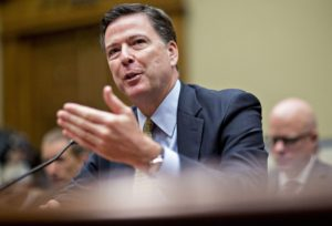 James Comey, director of the Federal Bureau of Investigation (FBI), speaks during a House Oversight and Government Reform Committee hearing in Washington, D.C., U.S., on Thursday, July 7, 2016. Comey defended his recommendation against pursuing criminal charges for Hillary Clinton over her use of private e-mail while secretary of state, testifying before Congress as he faced an onslaught of criticism from Republicans. Photographer: Andrew Harrer/Bloomberg