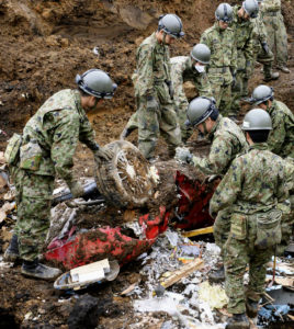 Members of Japan's Self-Defense Force check a car they dug out from a landslide site in Minamiaso, Kumamoto prefecture, Japan Monday, April 18, 2016. About 10 people remained missing Sunday in southern Japan from two powerful earthquakes. Rescuers were redoubling search efforts on the southern island of Kyushu, where many areas were cut off by landslides and road and bridge damage. (Takuya Inaba/Kyodo News via AP) J