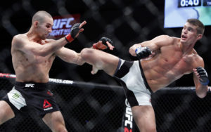 Stephen Thompson, right, kicks to the body of Rory MacDonald during a welterweight bout at UFC Fight Night 89 in Ottawa, Ontario on Sunday, June 19, 2016. (Fred Chartrand/The Canadian Press via AP)