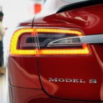 A customer views a Model S P85D electric vehicle (EV) at the Tesla Motors Inc. retail store in San Jose, California, U.S., on Thursday, Aug. 20, 2015. Tesla Motors Inc. has launched a wholesale revamp of its stores worldwide as the electric-car company prepares to debut the Model X, its first sport-utility vehicle. Photographer: Michael Short/Bloomberg