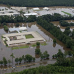 This aerial photo over Hammond, La., shows flooded Hammond Eastside Elementary Magnet School and Hammond High Magnet School after heavy rains inundated the region Saturday, Aug. 13, 2016. Louisiana Gov. John Bel Edwards says more than 1,000 people in south Louisiana have been rescued from homes, vehicles and even clinging to trees as a slow-moving storm hammers the state with flooding. (AP Photo/Max Becherer)