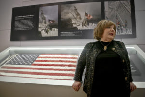 Shirley Dreifus, the original owner of the American flag, left, that firefighters hoisted at ground zero in the hours after the 9/11 terror attacks, speaks during an interview at the Sept. 11 museum, Thursday Sept. 8, 2016, in New York. After disappearing for more than a decade, the 3-foot-by-5-foot flag goes on display Thursday at the museum with assistance from Chubb Insurance.  (AP Photo/Bebeto Matthews)