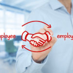 Employee and employer balanced cooperation concept. Businessman (human resources officer) draw scheme with hand shaking of employee and employer. Wide banner composition with office in background.
