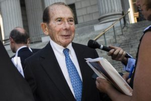 "Maurice ""Hank"" Greenberg, former chairman of American International Group Inc., speaks with members of the media after exiting Supreme Court of the State of New York in New York, U.S., on Tuesday, Sept. 13, 2016. More than 11 years after he was sued by former New York Attorney General Eliot Spitzer, Greenberg went on trial Tuesday to fight claims that he and former Chief Financial Officer Howard Smith rigged the books with two sham transactions at AIG to hide the insurer's true financial condition. Photographer: John Taggart/Bloomberg"