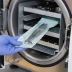 Sterilizing medical instruments in autoclave, color image