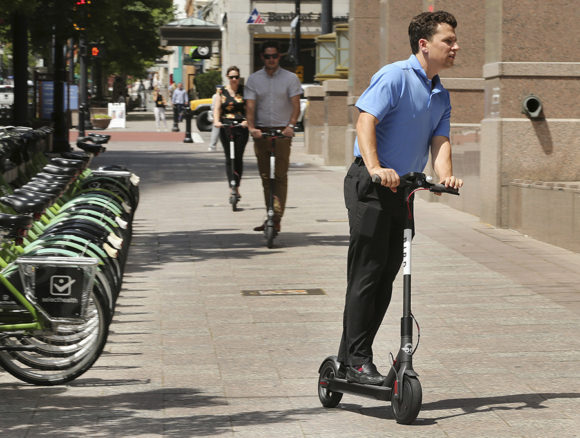 Suit Filed in California Says Scooters Rented by Uber, Segway Don't Have Turn Signals