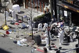 Investigators in haz-mat suits examine the scene of the second bombing on Boylston Street in Boston Tuesday, April 16, 2013 near the finish line of the 2013 Boston Marathon. (AP Photo/Elise Amendola)
