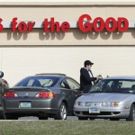 Shoppers leave Hoffman's Gun Center with their purchases in Newington, Conn., Tuesday, April 2, 2013. Customers are packing gun stores around Connecticut following the unveiling of new gun-control legislation. (AP Photo/Charles Krupa)