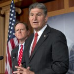 Sen. Joe Manchin, D-W.Va., right, accompanied by Sen. Patrick Toomey, R-Pa., announce that they have reached a bipartisan deal on expanding background checks to more gun buyers, Wednesday, April 10, 2013, on Capitol Hill in Washington.  (AP Photo/J. Scott Applewhite)
