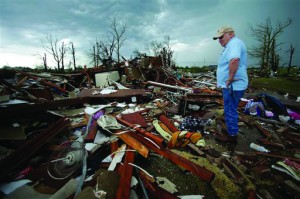 Monty Montgomery surveys the scene as he prepares to clean up a friend's tornado-ravaged home May 23, 2013, in Moore, Okla.  (AP Photo/Charlie Riedel)