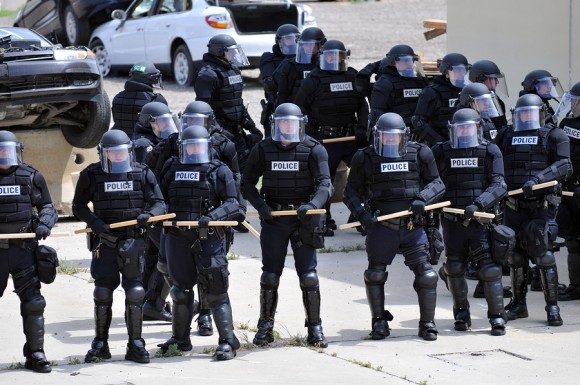 riot police political risk civil unrest