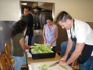 Abram Interstate Insurance employees prepare food for Loaves and Fishes
