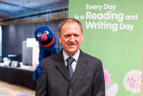 Bill Ross, CEO of the Insurance Industry Charitable Foundation, with Grover of Sesame Street, the long-running PBS-TV kids' educational program