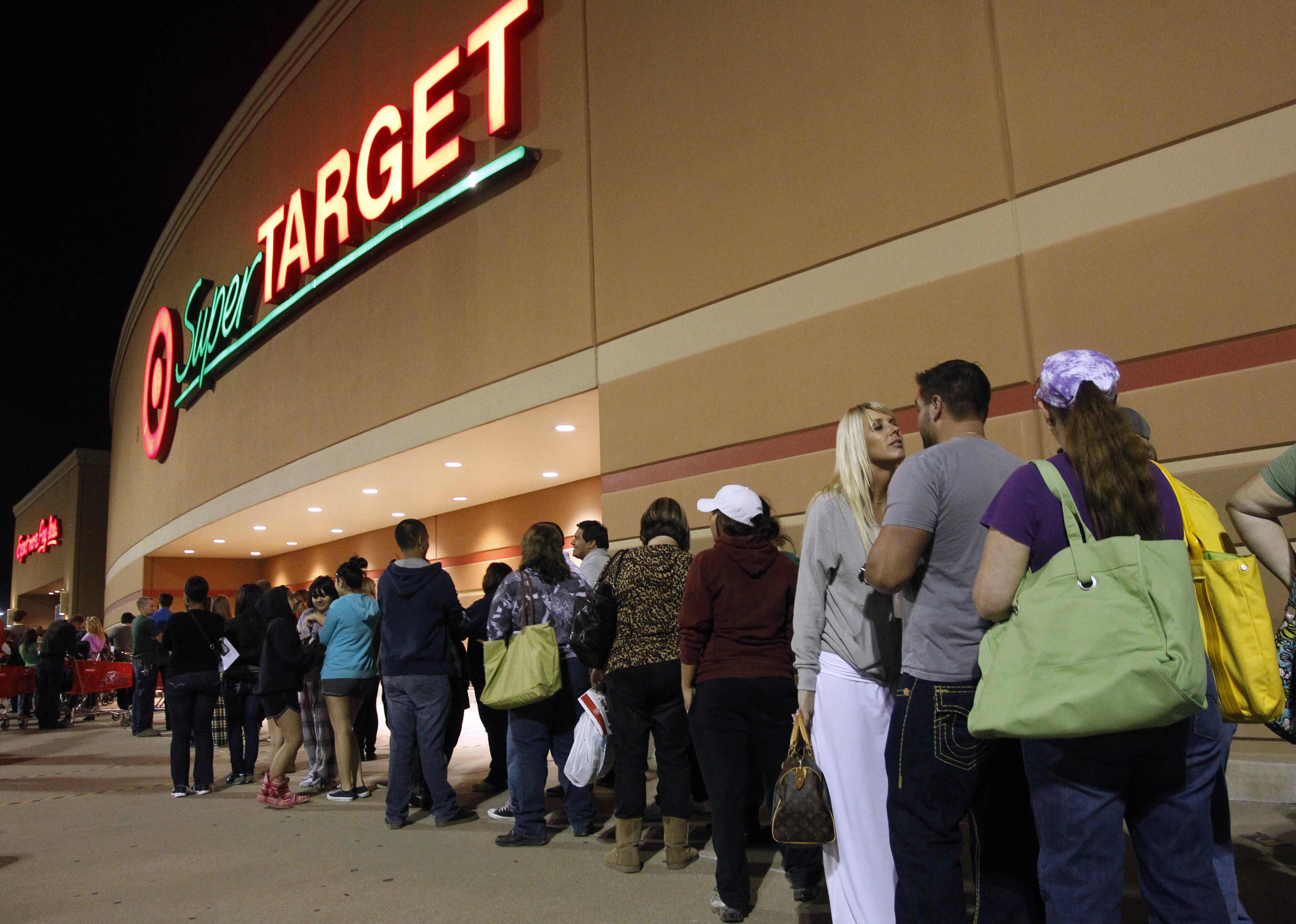 Shoppers line up at 8:30 p.m. Thursday in Dallas area Target store waiting for doors to open for Black Friday shopping Thursday, November 22, 2012. (Richard W. Rodriguez/ AP Images for Target)