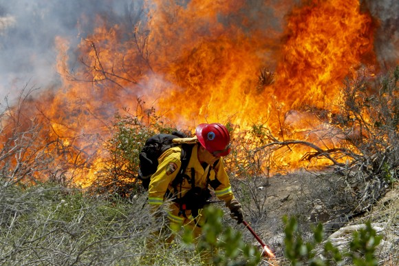 California Fire Capt. Mark Miller lights a backfire as he anCalifornia Fire Capt. Mark Miller lights a backfire as he and a crew from Oak Glen Fire Camp in Riverside try to knock down a brush fire near Oriole Court in Carlsbad, Calif., on Wednesday, May 14, 2014. (AP Photo/U-T San Diego, Hayne Palmour IV)d a crew  try to knock down a brush fire near Oriole Court in Carlsbad, Calif., on Wednesday. Thousands were asked to evacuate their homes in Carlsbad after the blaze erupted at about 10:34 a.m. Wednesday and spread through rapidly heavy brush before jumping into residential areas. (AP Photo/U-T San Diego, Hayne Palmour IV)