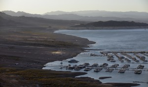 Wind kicks up dust on an area that was once under water at Hemenway Harbor in the Lake Mead National Recreation Area in Nevada. As the lake levels drop the floating marinas move to adjust to the changing shoreline. (AP Photo/John Locher)