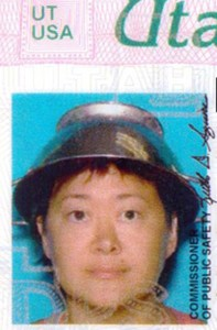 Asia Lemmon, whose legal name appears on her driver's license as Jessica Steinhauser, is shown wearing a metal colander on her head on her Utah driver's license.  Lemmon says the pasta strainer represents her beliefs in the Church of the Flying Spaghetti Monster and says state employees  took the photo after she presented them with documents on religious freedom. (AP Photo/Utah Department of Motor Vehicles via The Spectrum)